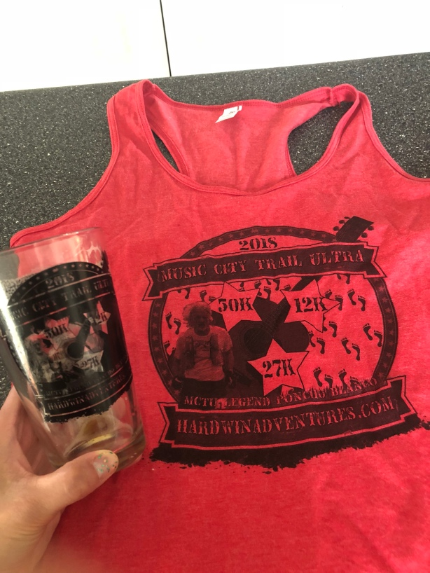 Cool tank top and finishers pint glass.